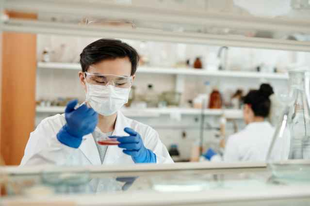 man doing a sample test in the laboratory