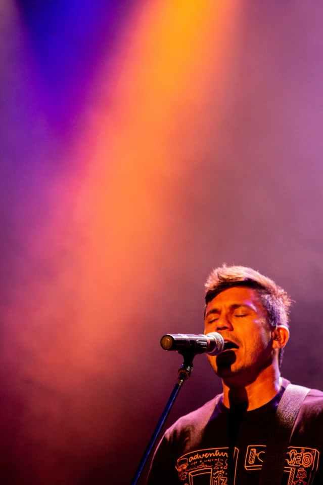 man singing in concert event